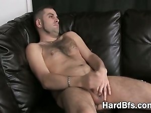 Hot guy massaging his large penis